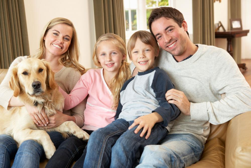 Family happy to have their pet healthy.
